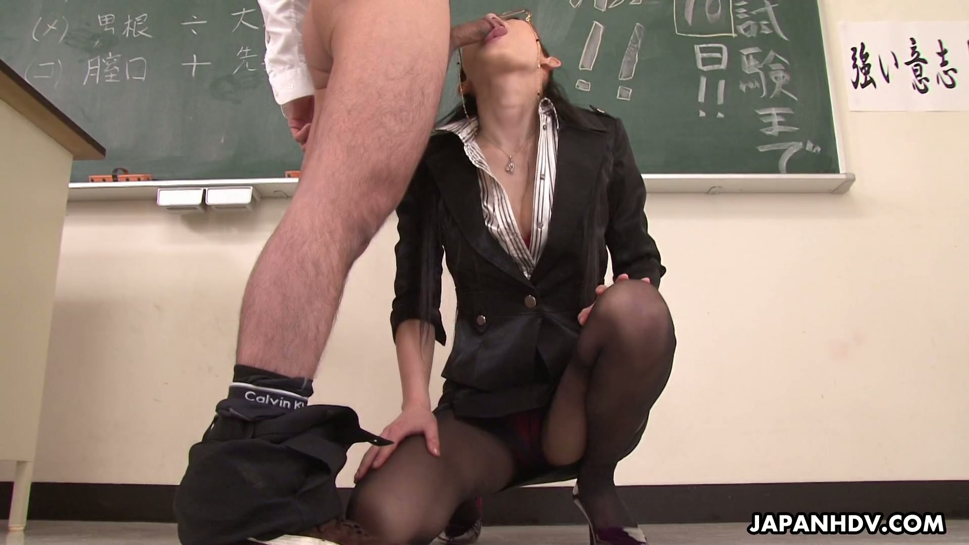 Hot Asian teacher in glasses sucks tasty penis of her student with passion