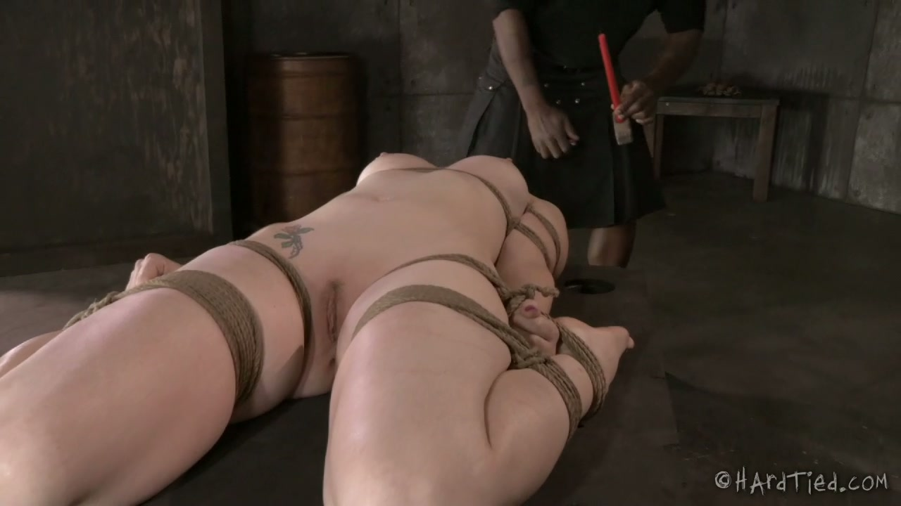 Black BDSM master covers his sweet blond hottie with hot wax
