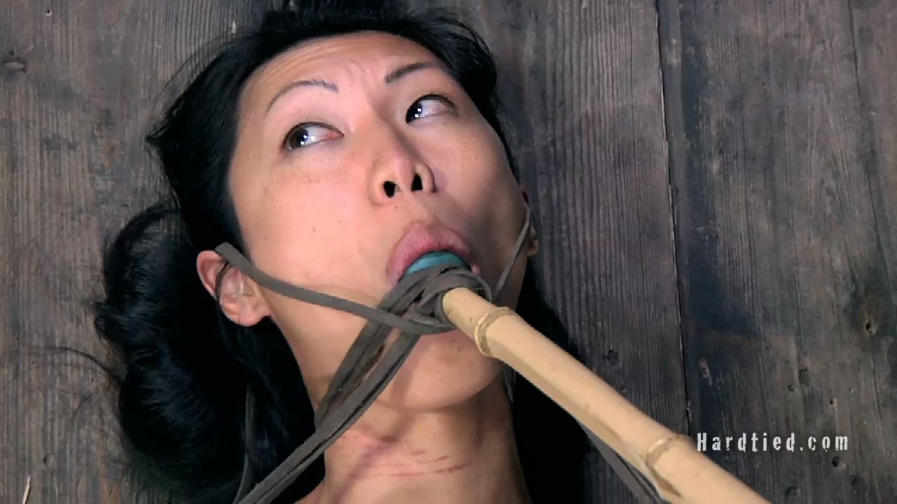 Fuckable Asian whore gets her shaved brown pussy nailed hard in BDSM sex scene