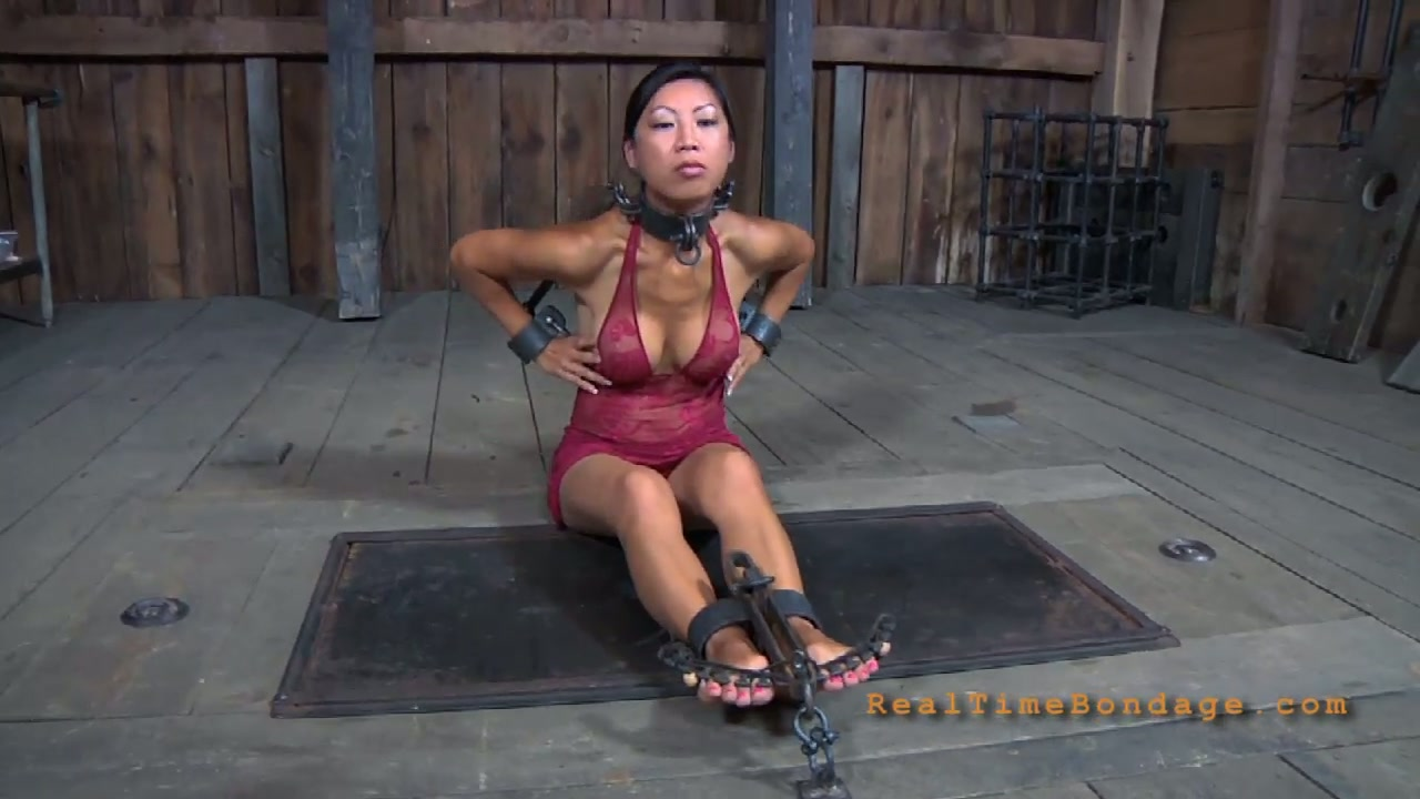 Juggy Asian hussy gets her hands and legs handcuffed in BDSM sex scene