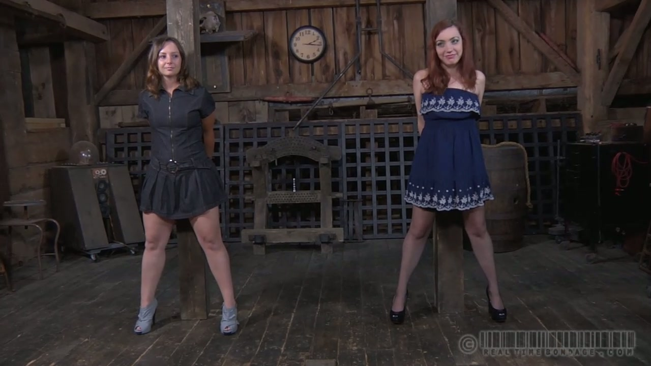 Two shy young cuties gets tied to the metal bars in BDSM sex play