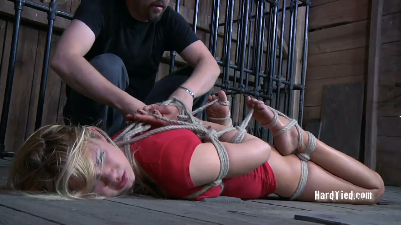 Ruined blond chick gets her hands tied up to her legs in BDSM sex scene