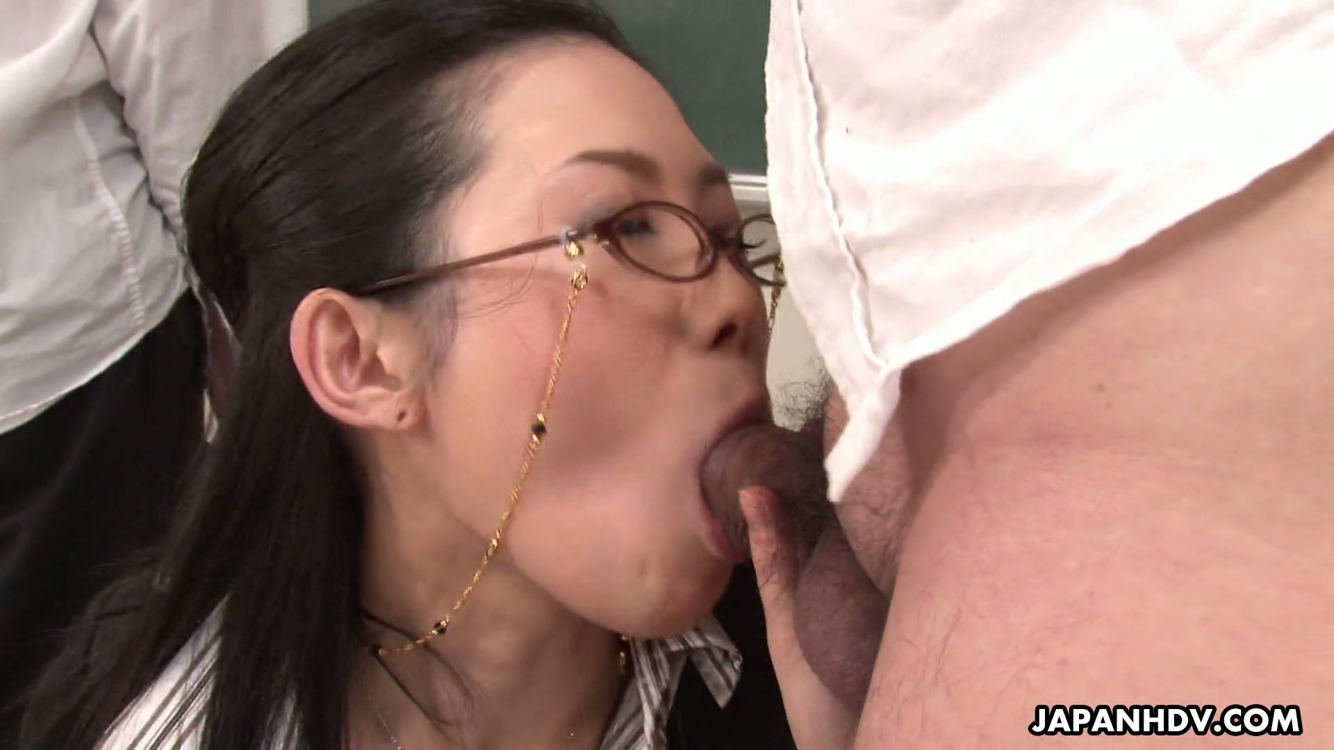 Filthy Asian teacher in glasses performs stout blowjob to her student