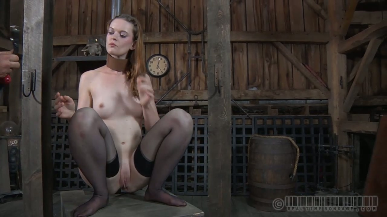 Fuckable red-haired hussy gets her mouth stuffed with a gag in BDSM sex scene