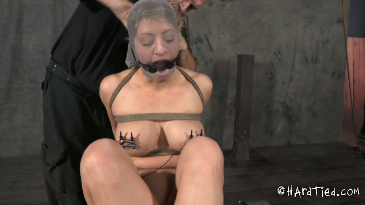 Skanky blond chick gets her head covered with stocking in BDSM sex scene