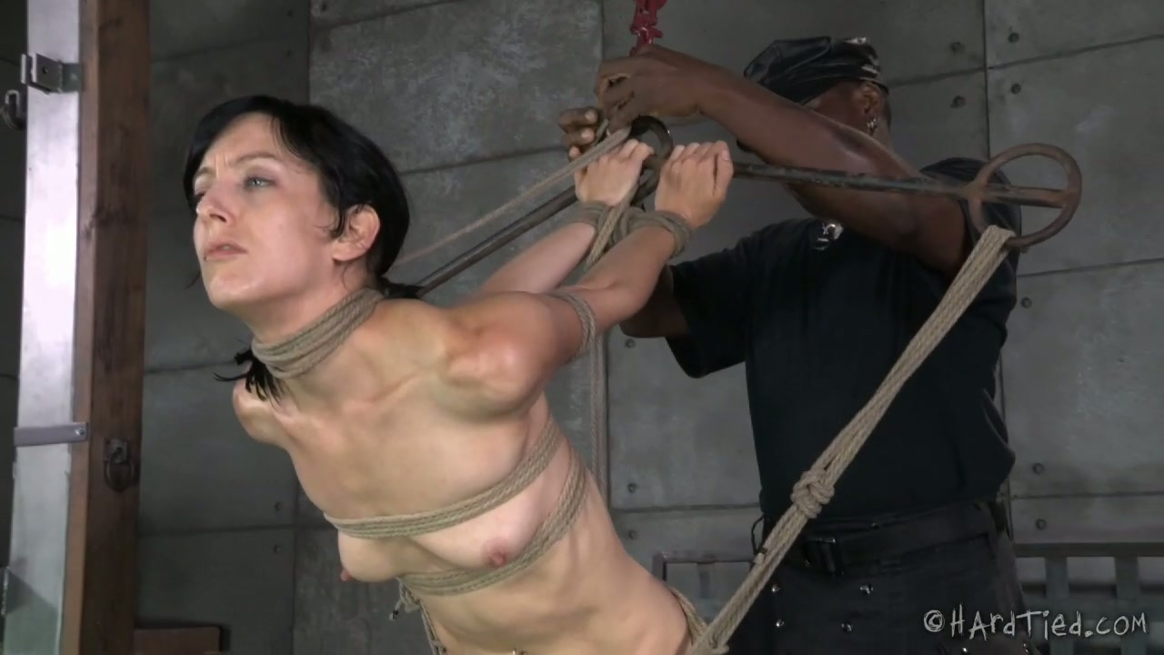 Black BDSM stud whips his bound white girlie hard