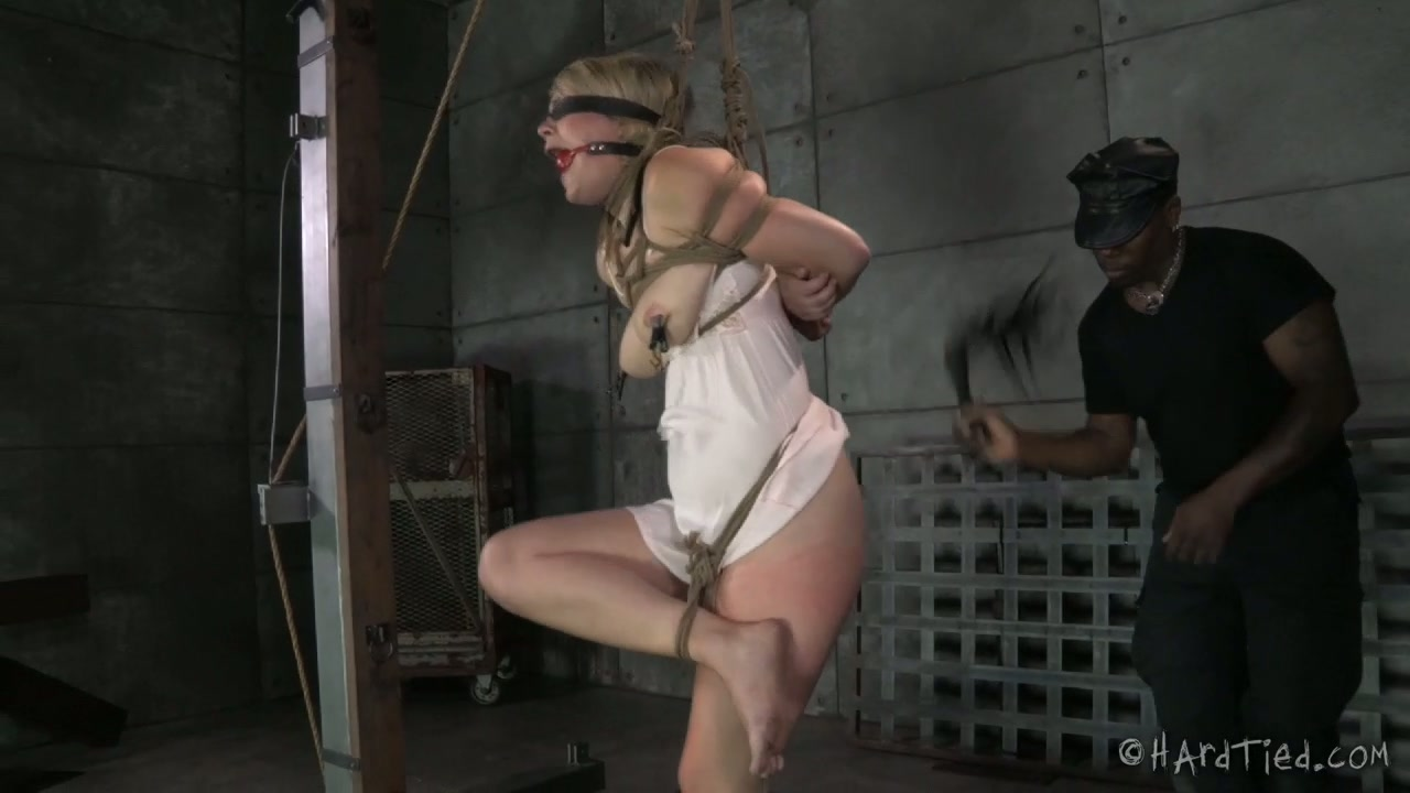 Black BDSM man whips tied up blond cutie Winnie Rider tough