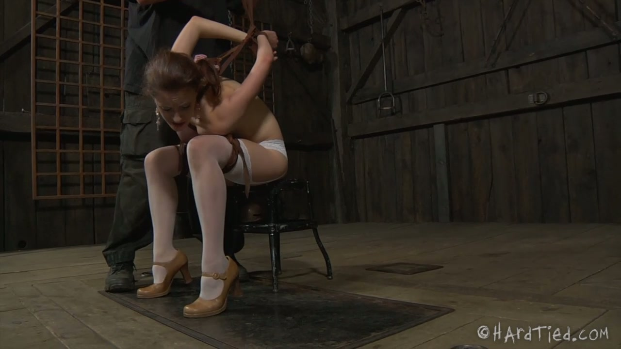Juggy red-haired cutie gets her tits squeezed with rope in BDSM sex scene