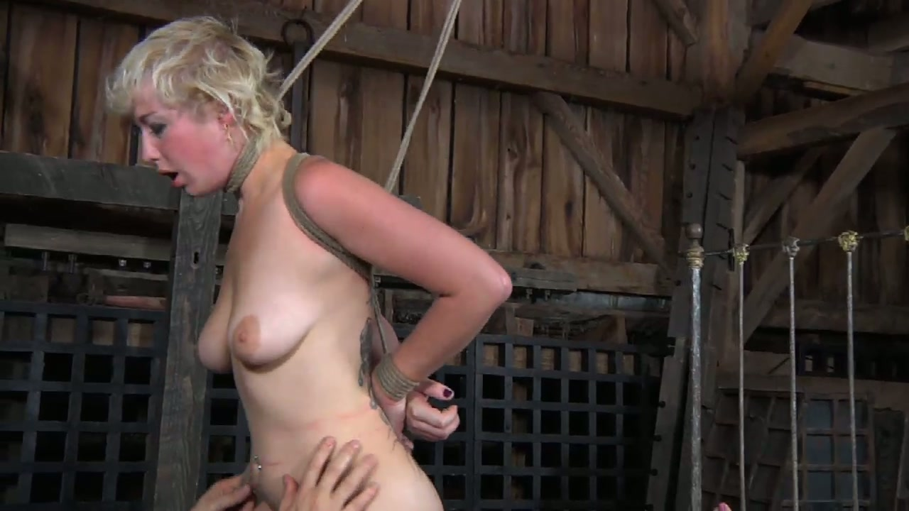 Worn out blond tattooed bitch rides stiff cock of her master in cowgirl style in BDSM sex scene