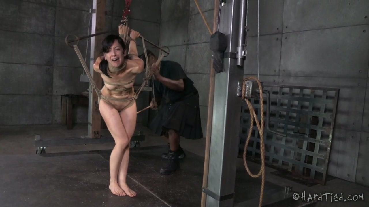 Black BDSM stud whips his bound white girlie hard
