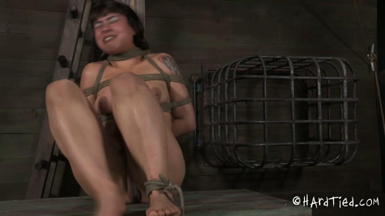 Ample dark haired hussy gets her legs spread aside in BDSM sex scene