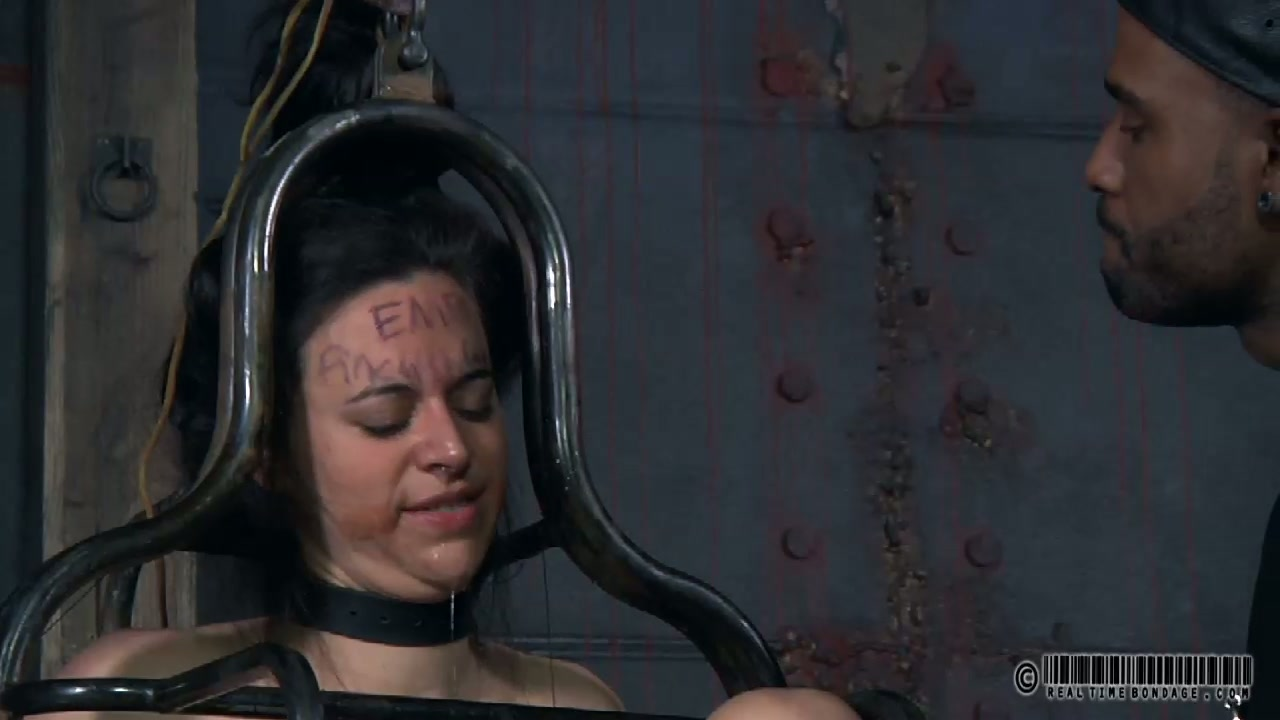 Chubby dark haired teen gets her body fastened in metal cage during BDSM sex play