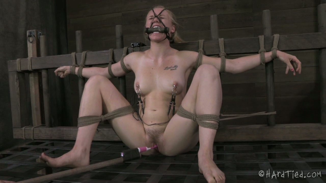 Shabby looking blond hussy gets her pussy pounded with dildo in BDSM sex vid
