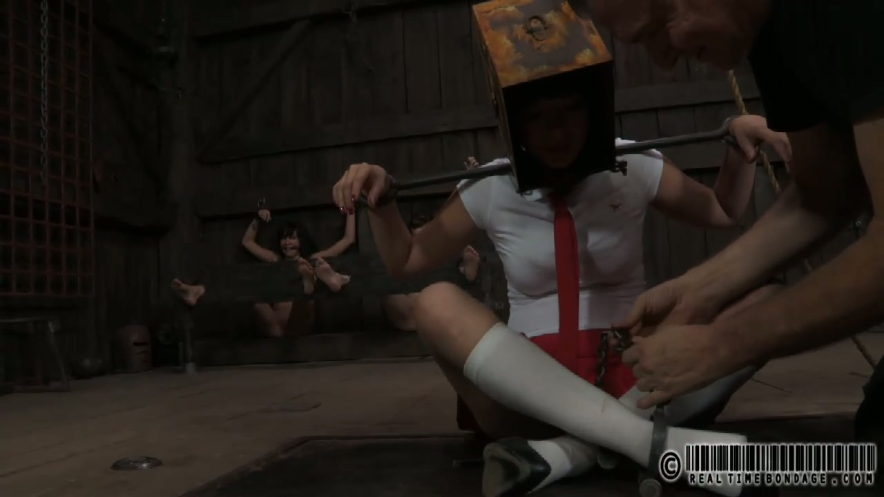 Playful Japanese student gets her head stuck in wooden box in BDSM sex scene