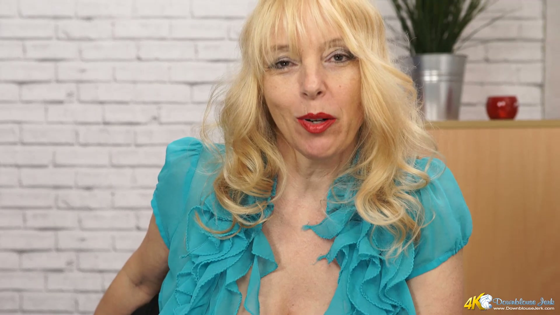 Blonde mature lady Lucy Gresty exposes her big boobs