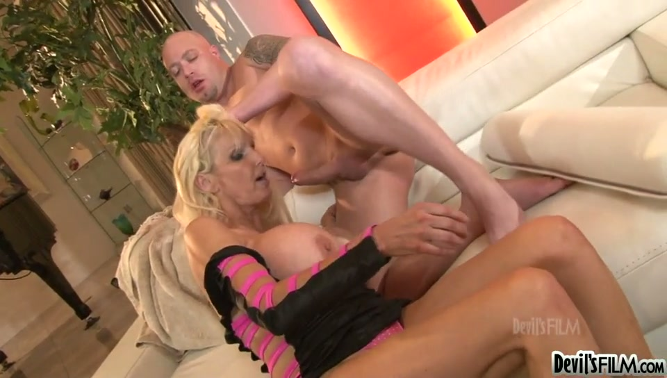 Mature blond whore with huge fake boobs Tia Gunn gets banged in mish pose