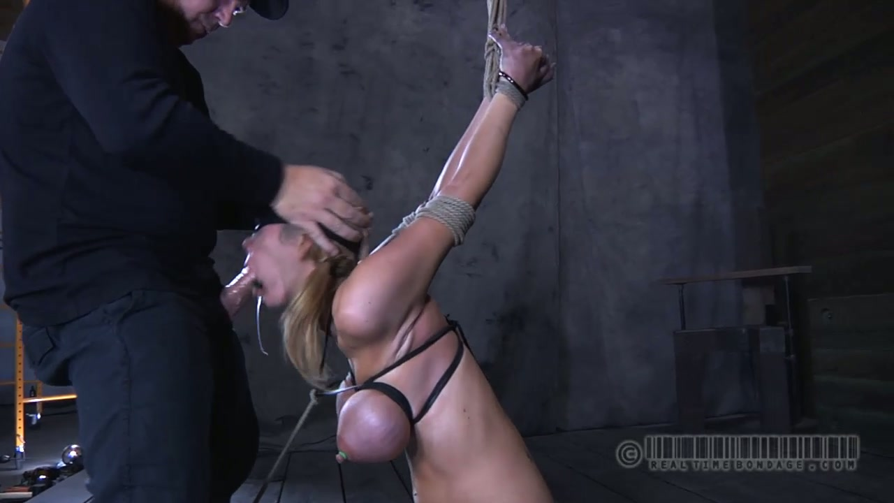 Busty blond doxy is made to suck hard thick dick in BDSM sex scene