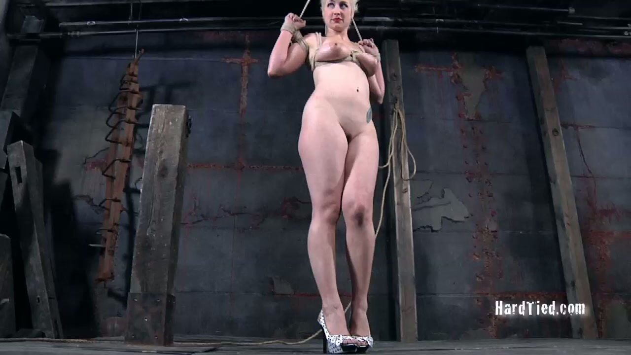 Juggy blond porn star gets her tits pinched with metal pegs in BDSM sex scene
